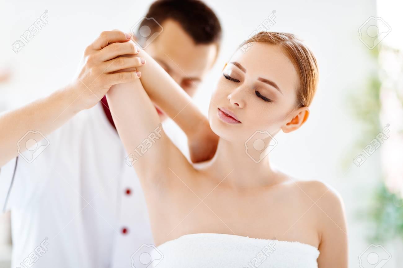 a beautiful girl enjoys massage and spa treatments - 102008160