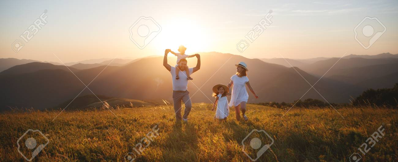 Happy family: mother, father, children son and daughter on nature on sunset - 105557338