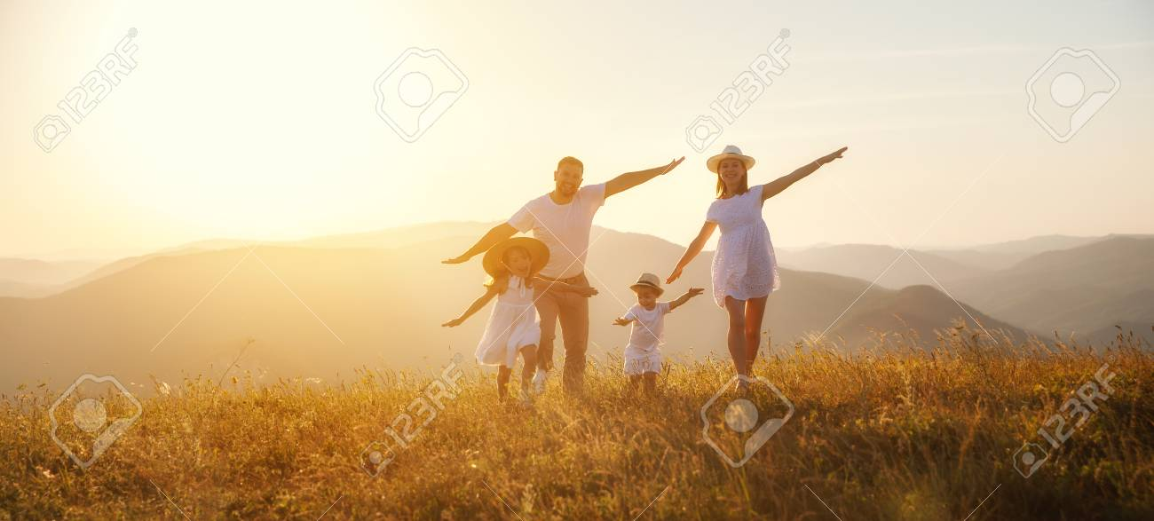 Happy family: mother, father, children son and daughter on nature on sunset - 105557354