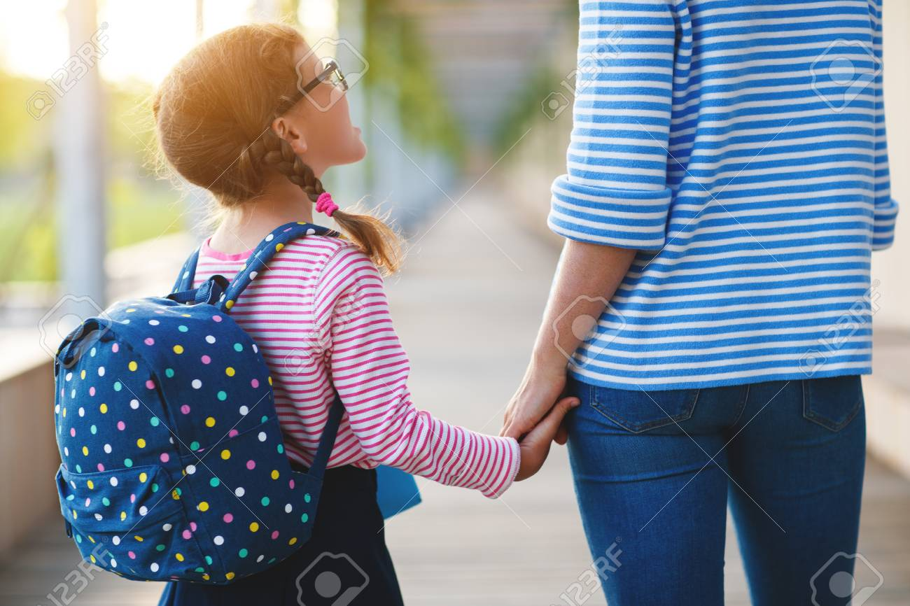 first day at school. mother leads a little child school girl in first grade - 106439666