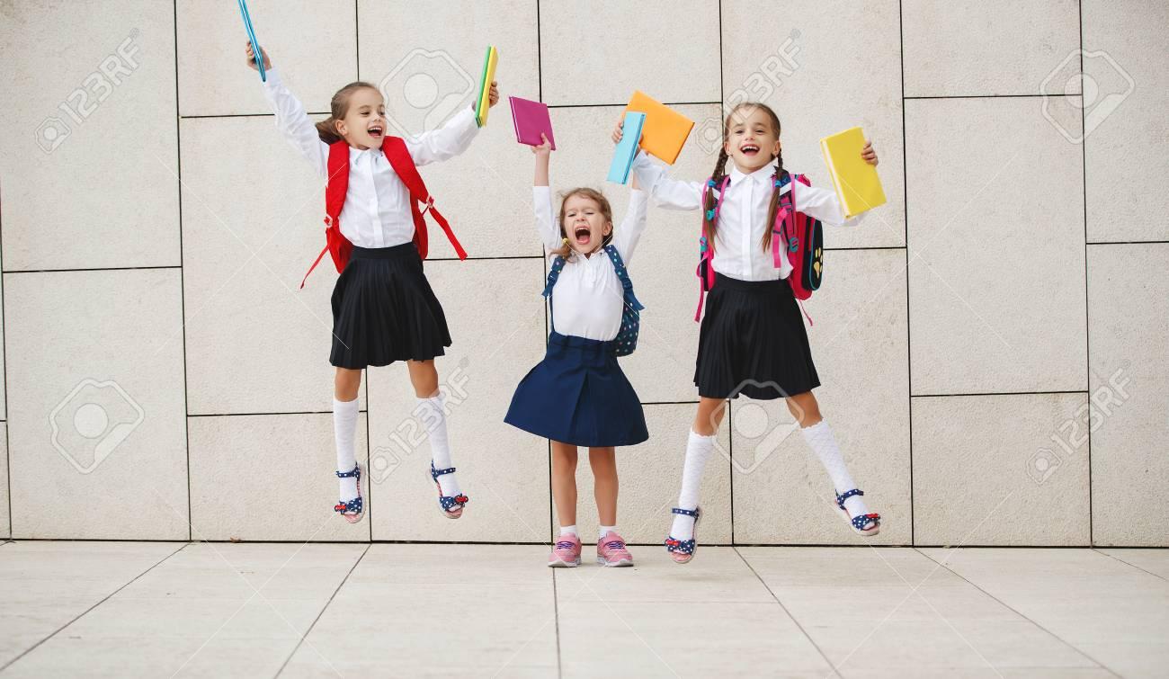 Happy children girls girlfriend schoolgirl student elementary school - 107007292