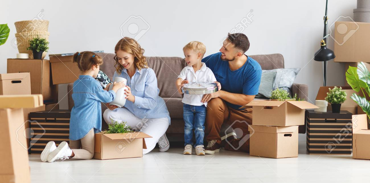 happy family mother father and children move to a new apartment and unpack boxes - 109984080