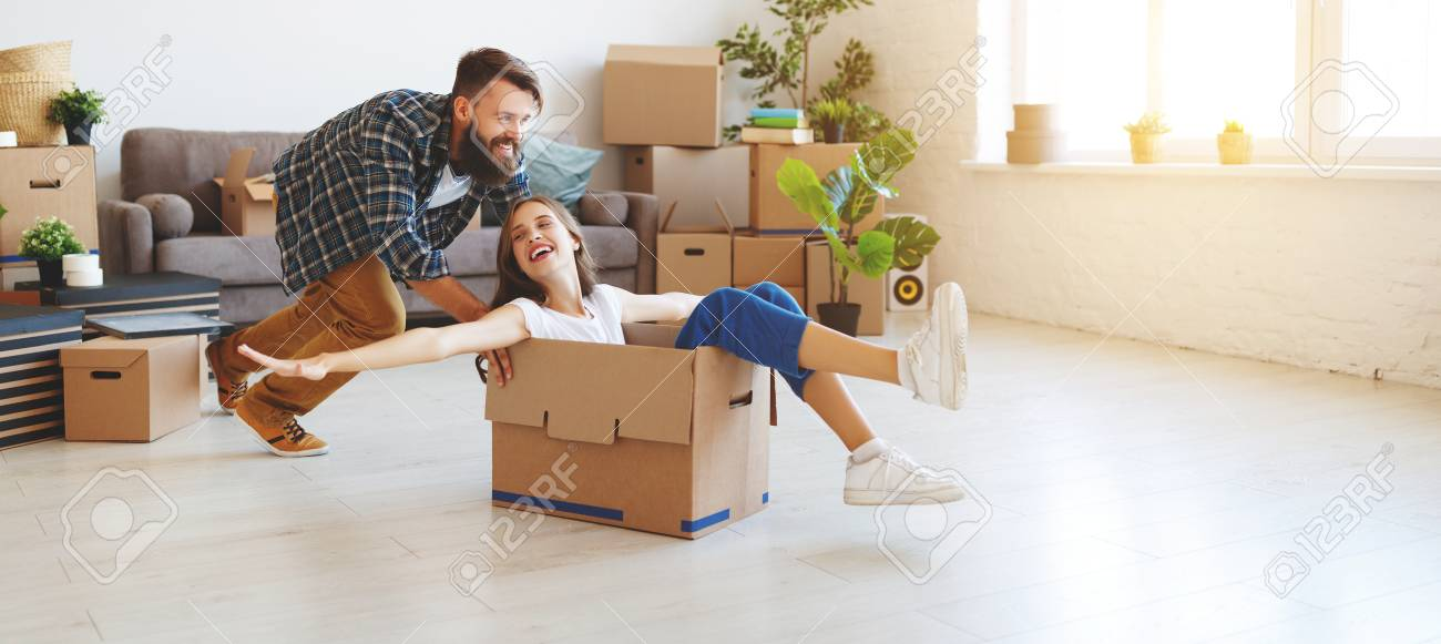a happy young married couple moves to new apartment - 111796365