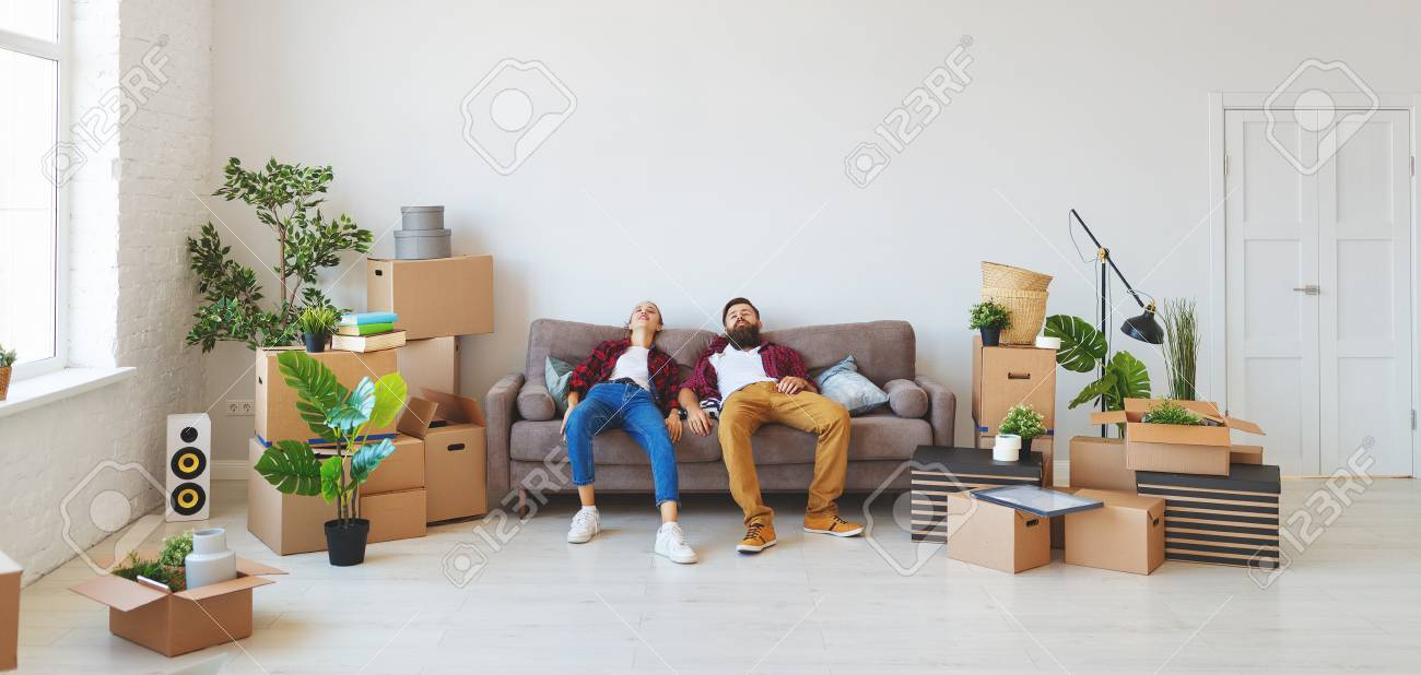 a happy young married couple moves to new apartment - 115271207