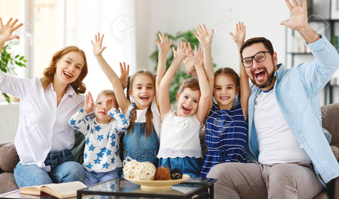 Happy large family mother, father and children sons and daughters at home - 119497023
