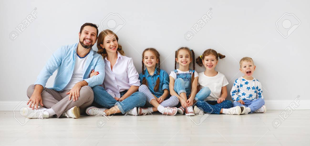 Happy large family mother, father and children sons and daughters on white background - 119497025