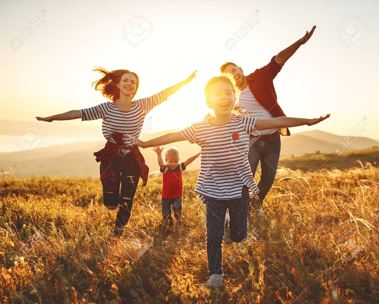 Happy family: Mother, father, children son and daughter on nature on sunset - 120402746