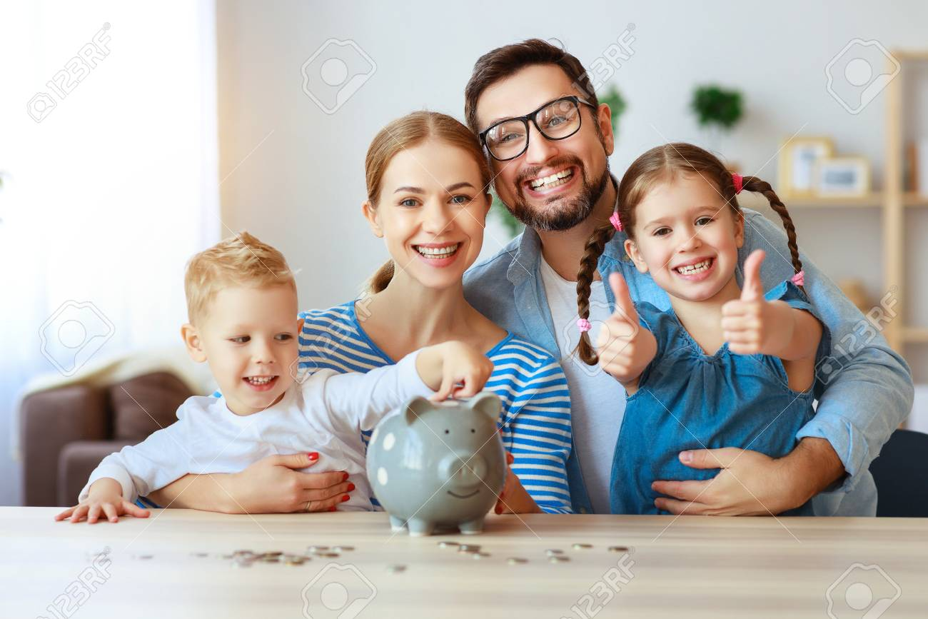 Financial planning happy family mother father and children with piggy Bank at home - 120628943