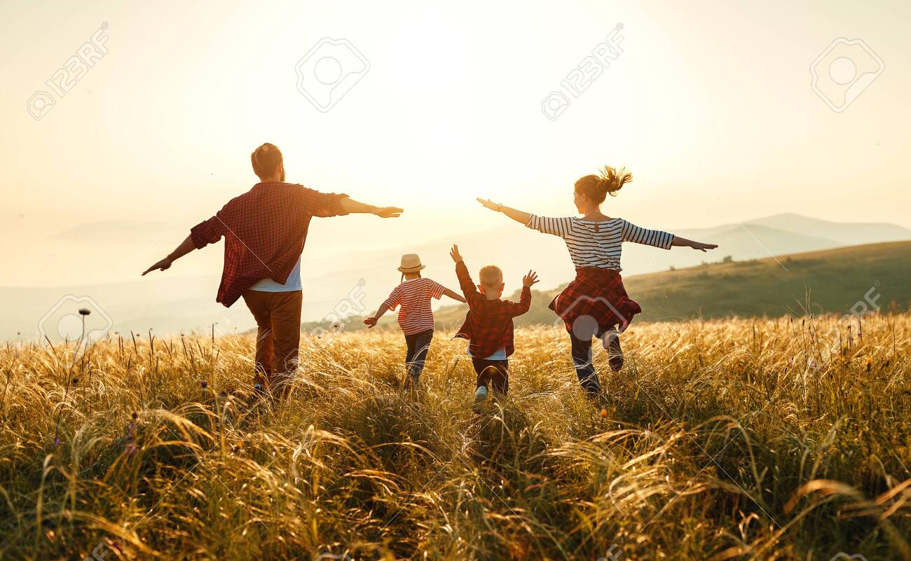Happy family: mother, father, children son and daughter on nature on sunset - 127877169
