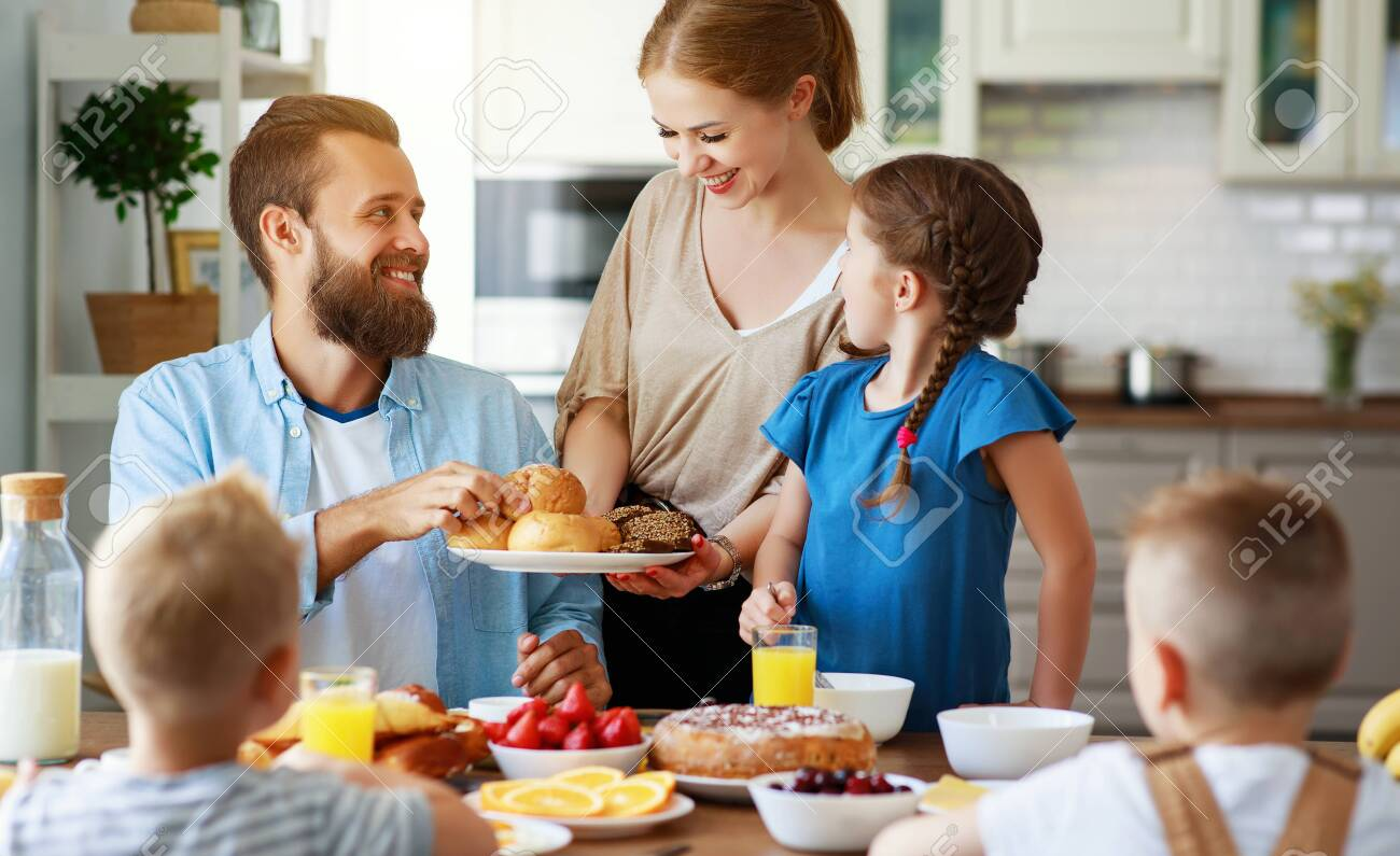 family mother father and children have Breakfast in the kitchen in morning - 130187030