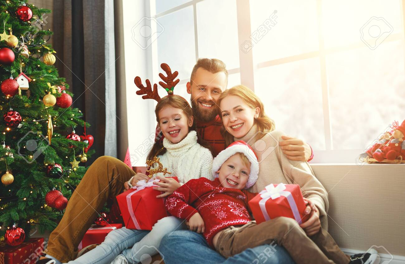 happy family parents and children open presents on Christmas morning - 132718850