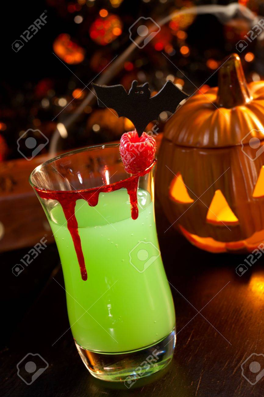 Closeup of Vampire's Kiss Cocktail, rum, melon liqueur, soda and touch of tabasco, garnished with fresh raspberry - Halloween drinks series Stock Photo - 5778199