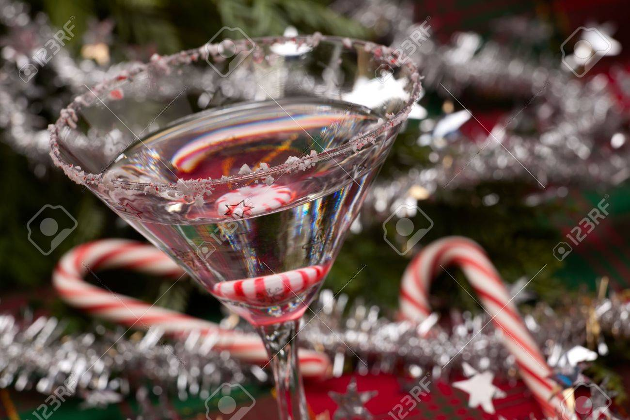 Glass candy cane ornaments - Closeup Of Glass Of Candy Cane Martini And Christmas Ornaments Stock Photo 5960547