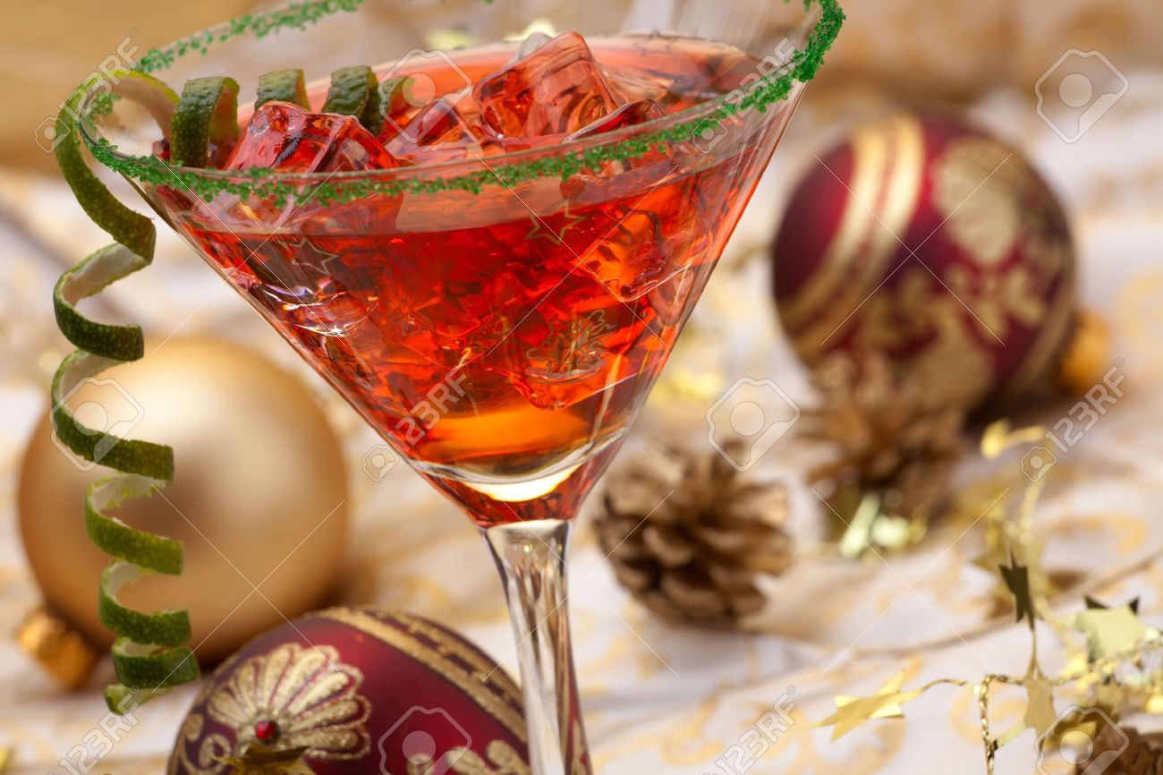 Glass of Christmas Cocktail in martini glass and Christmas ornaments Stock Photo - 5960526