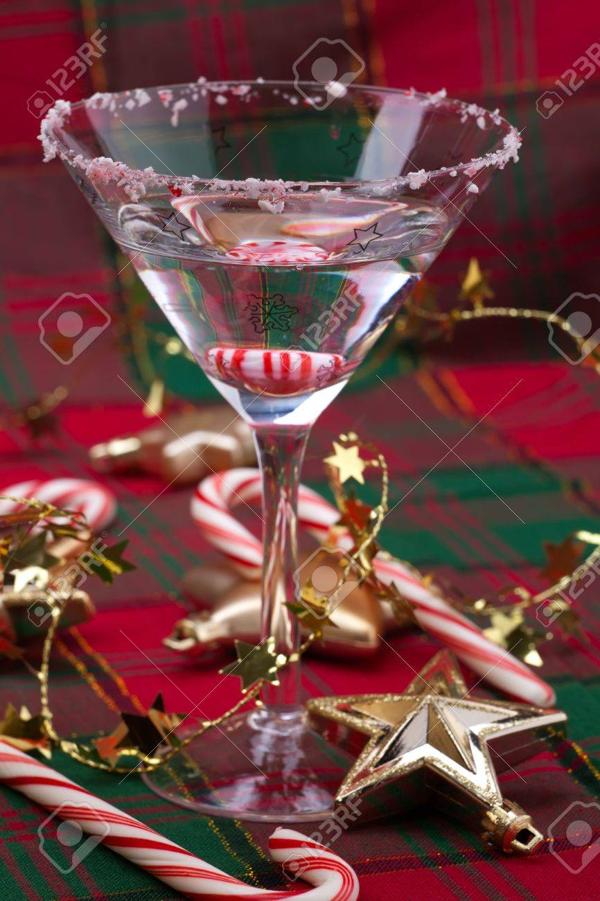 Glass candy cane ornaments - Closeup Of Glass Of Candy Cane Martini And Christmas Ornaments Stock Photo 6001205