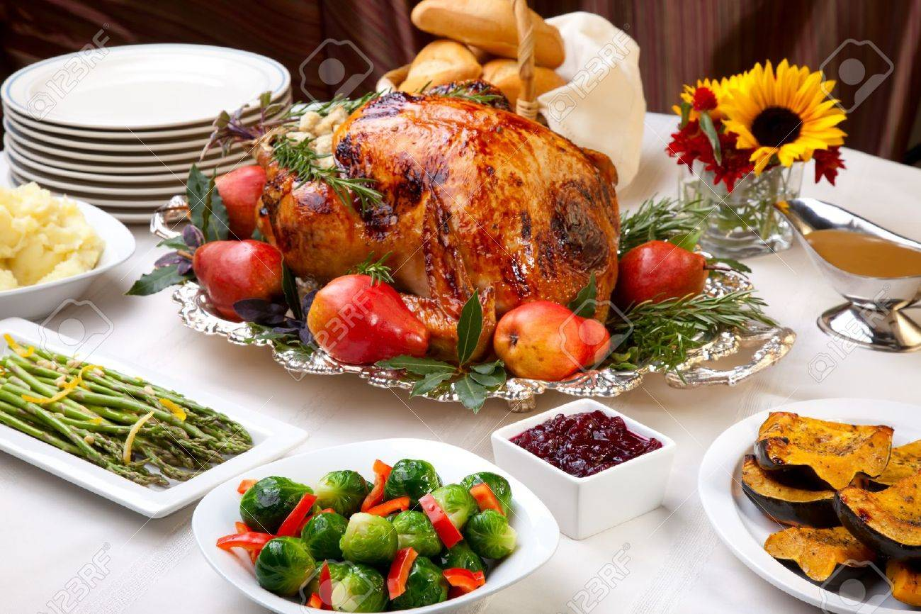 Delicious roasted turkey with savory vegetable side dishes in a fall theme Stock Photo - 7408748