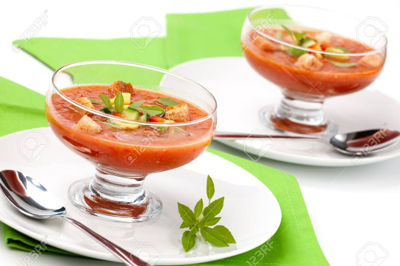 Two Bowls Of Delicious Cold Gazpacho Soup With CucumberAvocado