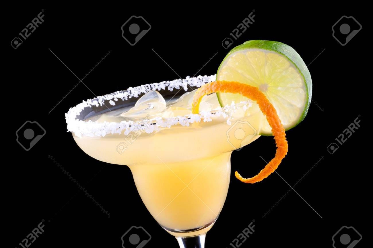 Orange Margarita in chilled glass over black background on reflection surface, garnished with fresh lime and orange. Most popular cocktails series. Stock Photo - 9961389
