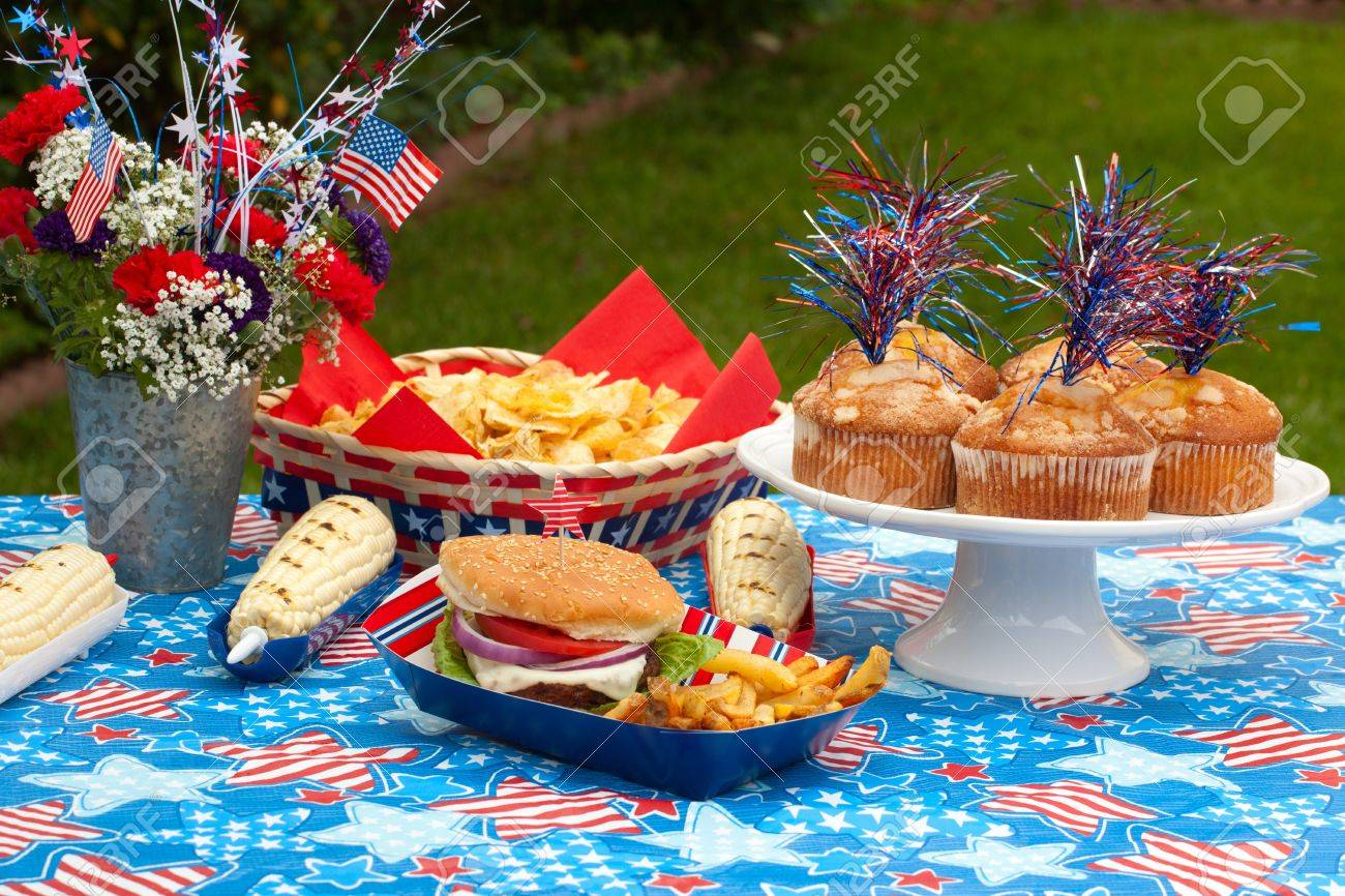 Cornbread, corn and burgers on 4th of July picnic in patriotic theme Stock Photo - 13719758