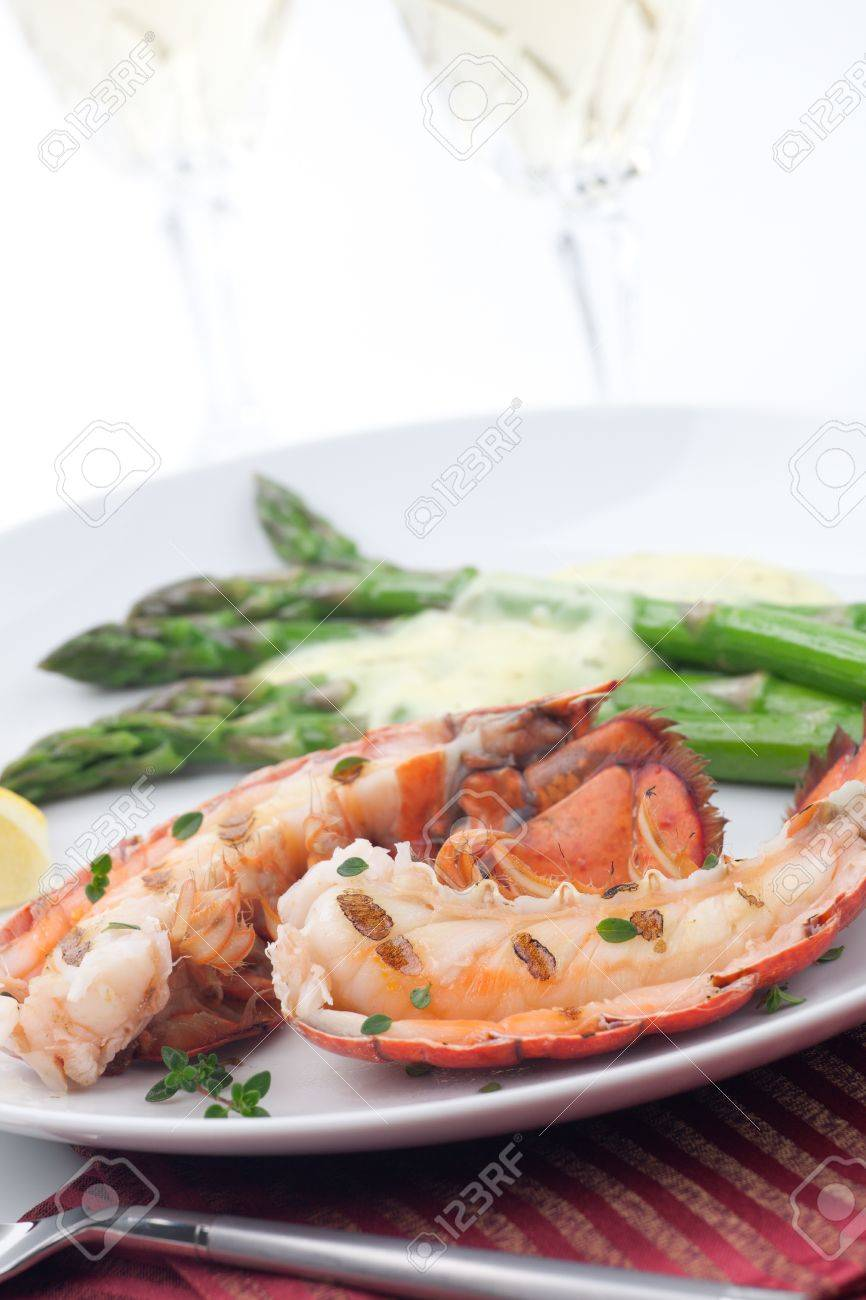 Closeup of delicious grilled lobster tails served with asparagus and bearnaise sauce Stock Photo - 14177694