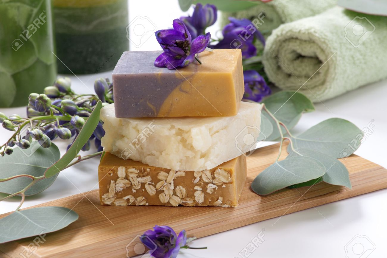 Spa set - assorted aromatic organic handmade soap, fresh Delphinium flowers, and eucalyptus leaf  Best suited for relaxing and health commercials Stock Photo - 15524292