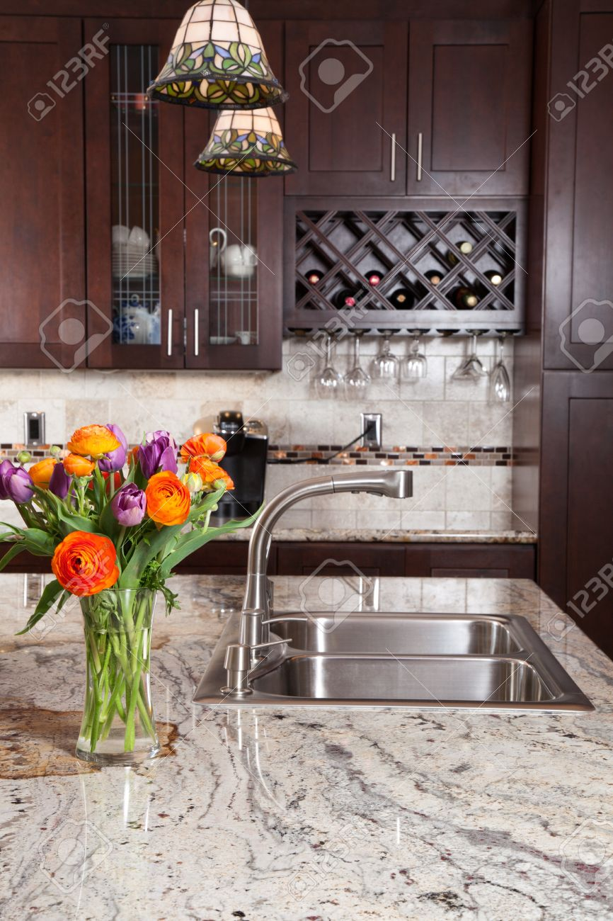 Modern House New Contemporary Luxury Custom Kitchen And Refreshments On Exotic  Granite Countertop Stock Photo