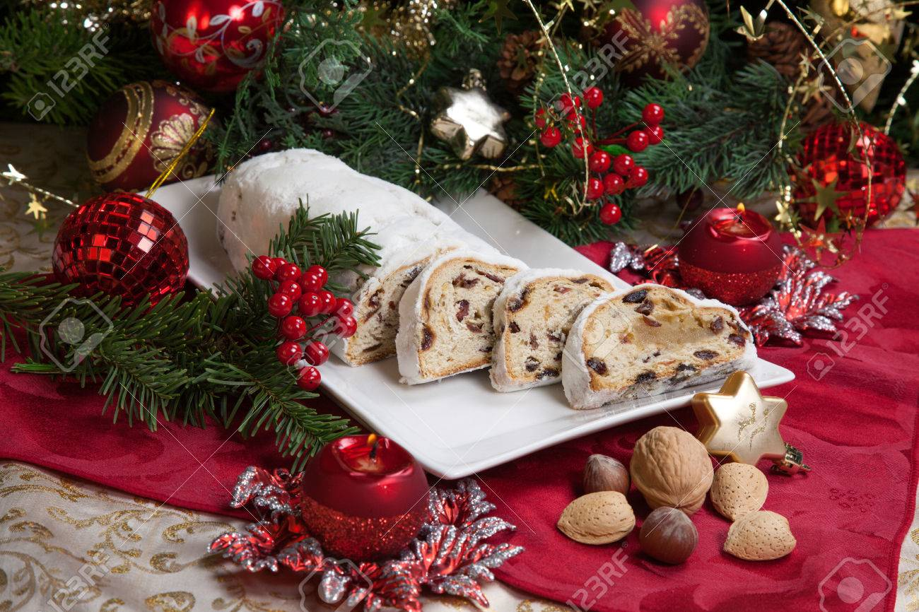 German christmas tree ornaments - Traditional German Christmas Cake Cranberry Stollen Christmas Tree Ornaments And Candles Stock