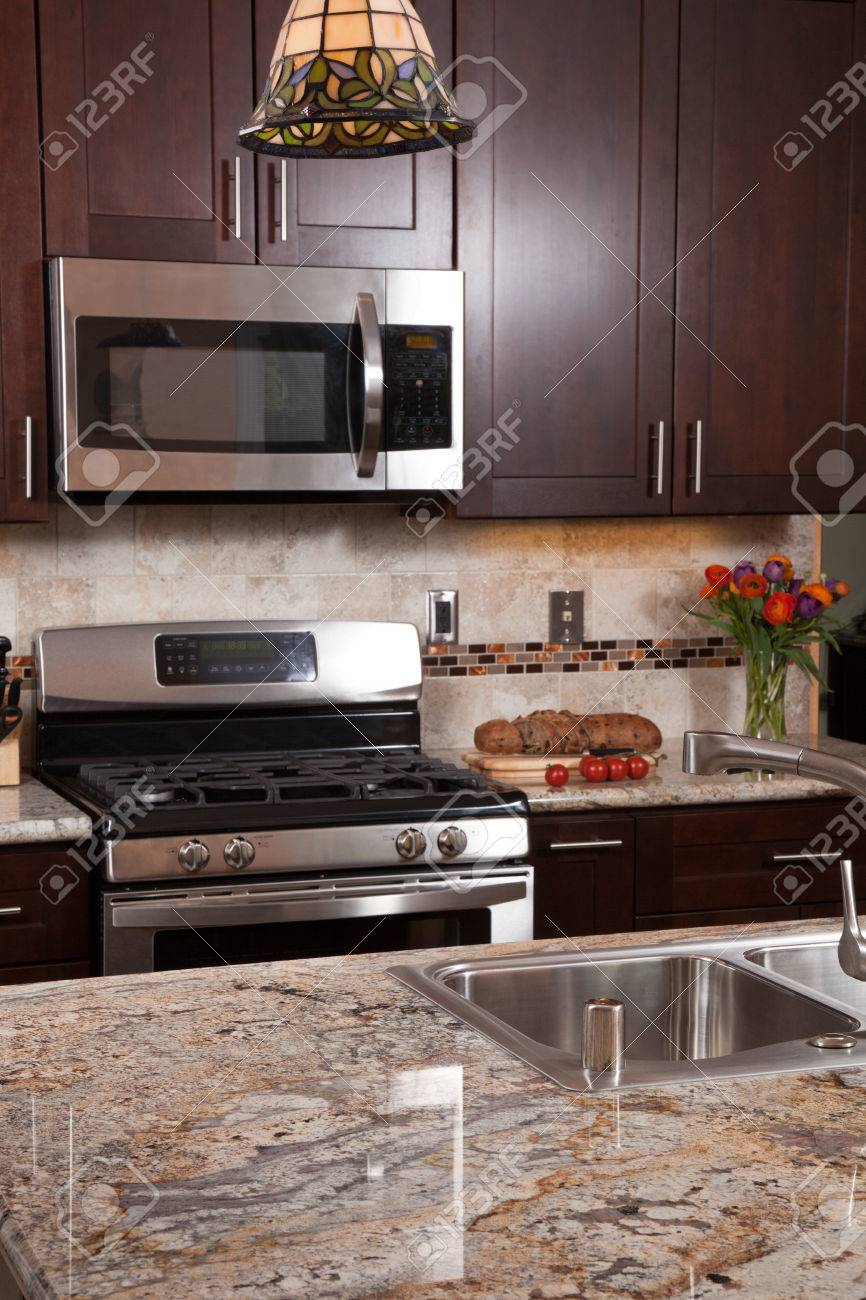 Modern house new contemporary luxury custom kitchen and refreshments on exotic granite countertop - 26589085
