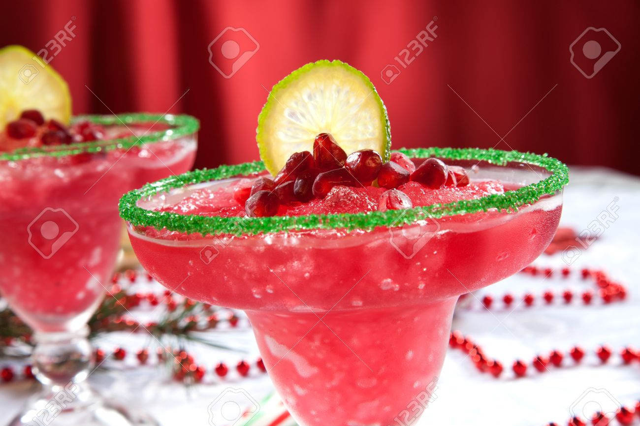 Margarita ornament - Stock Photo Two Frozen Pomegranate Margaritas Cocktails On Christmas Decorated Holiday Table With Christmas Ornaments Holiday Cocktails Series