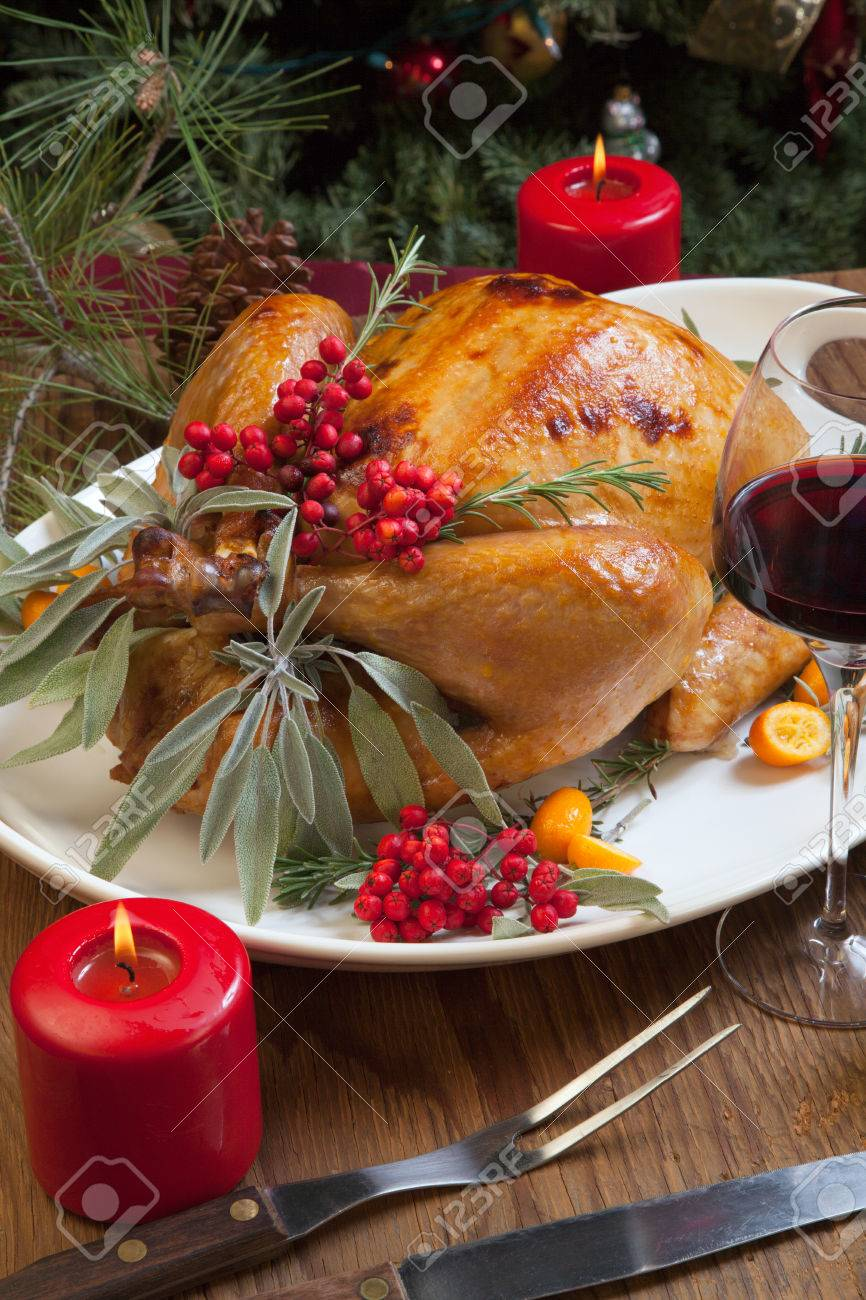 Roasted Turkey Garnished With Sage, Rosemary, And Red Berries ...