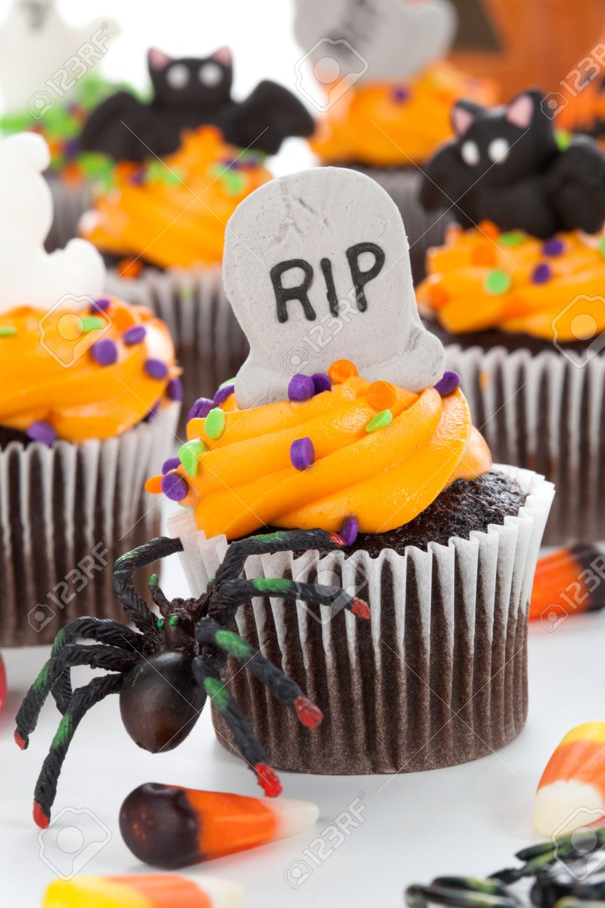 halloween cupcake with rip ghost and bat decorations surrounded by halloween cupcakes corn - Halloween Decorations Cupcakes