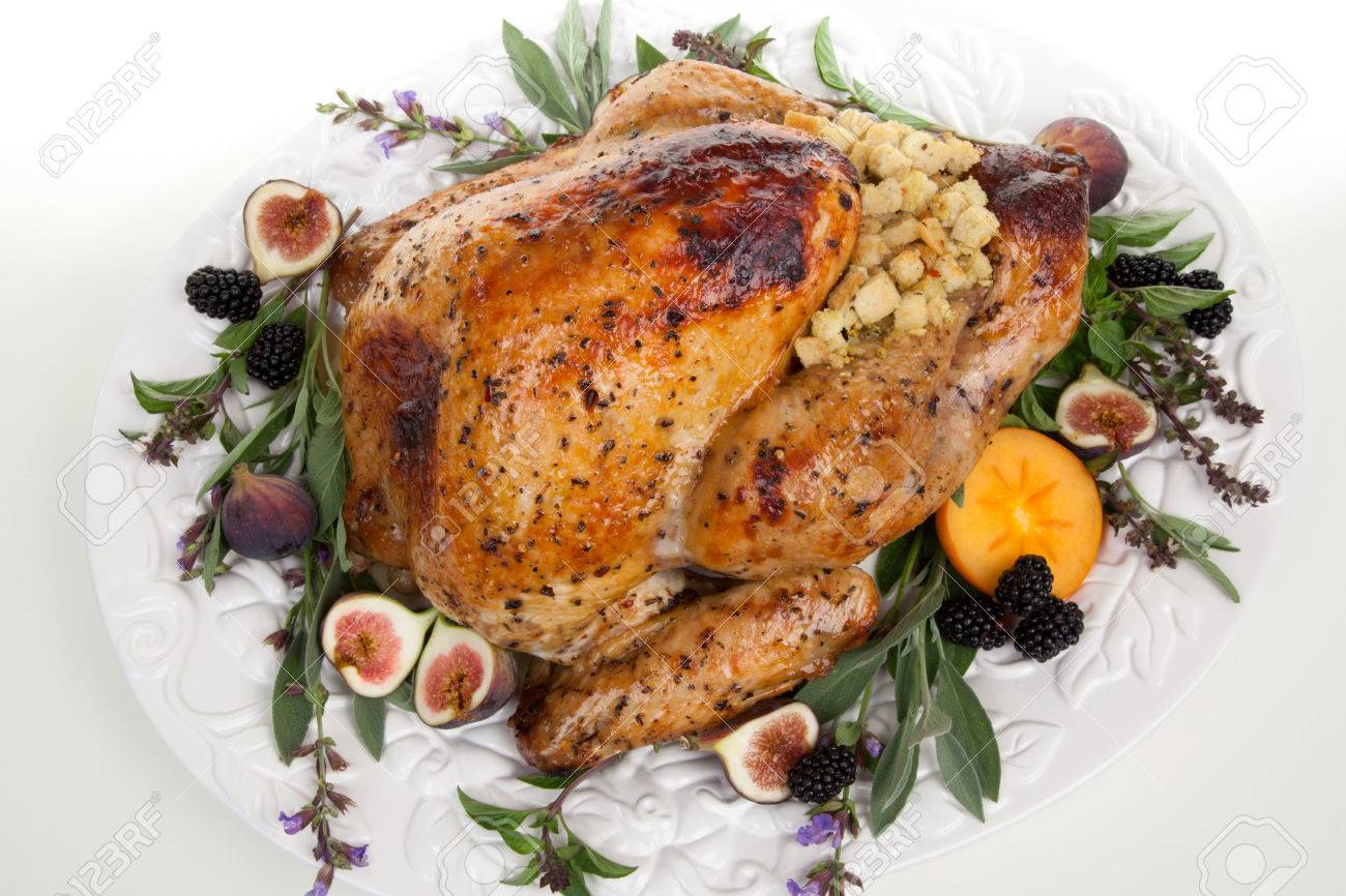 Glazed Roasted Turkey On Serving Tray Over White Background Stock Photo Picture And Royalty Free Image Image 65273378