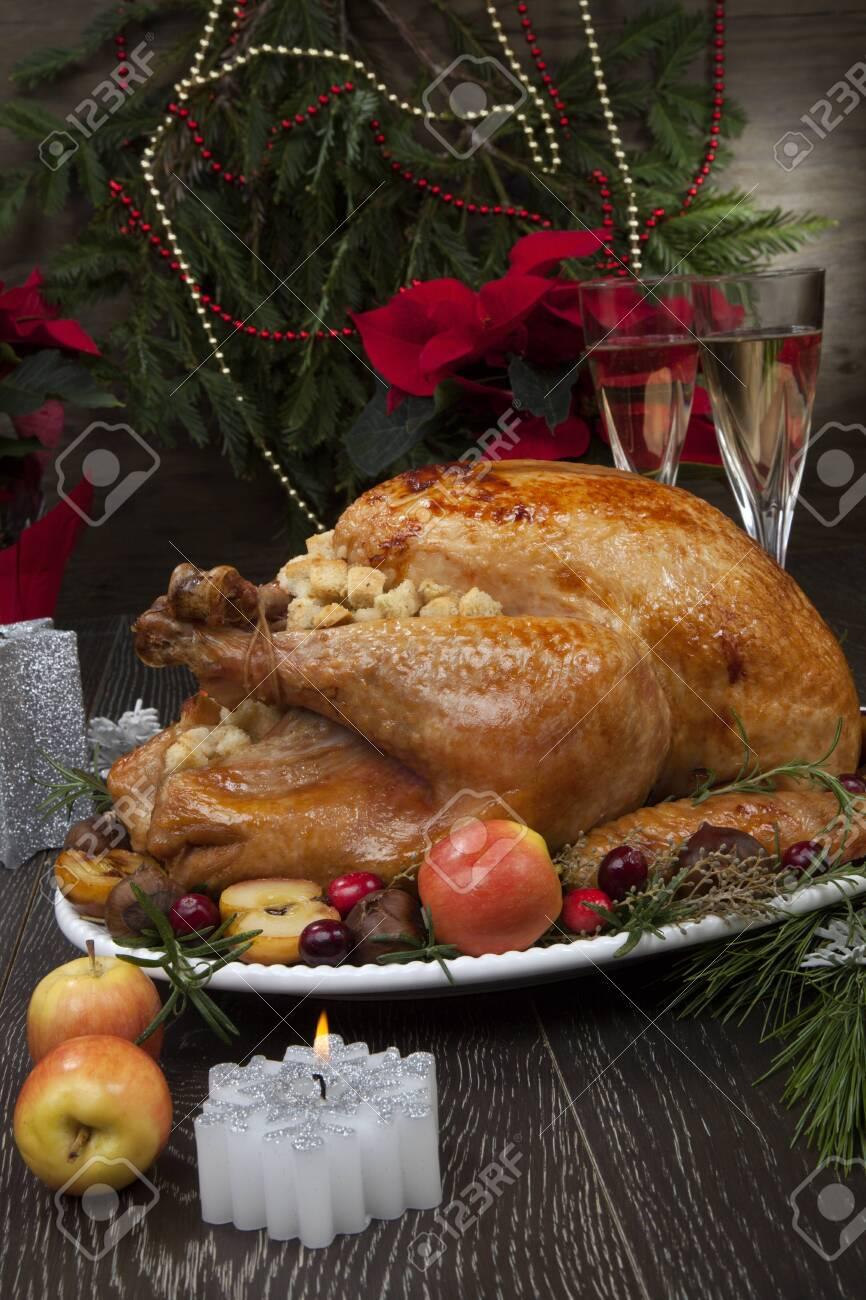 Garnished roasted Christmas turkey - 133925936