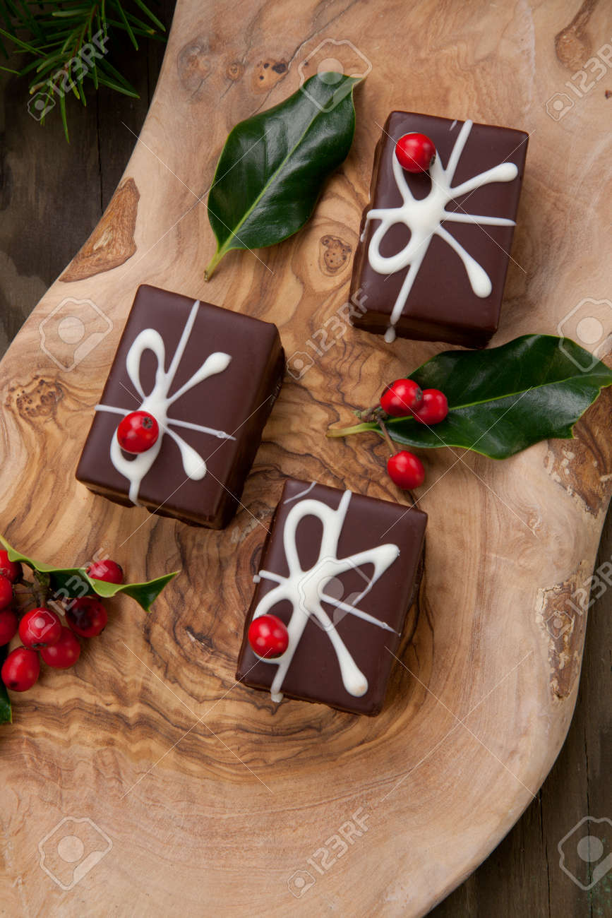 Traditional Christmas chocolate candy, Christmas ornaments, decorations, and red berries. - 159802017