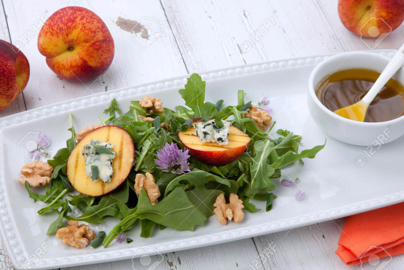 Closeup of blue cheese and peach salad with walnut and arugula. Freash peaches. - 164958974