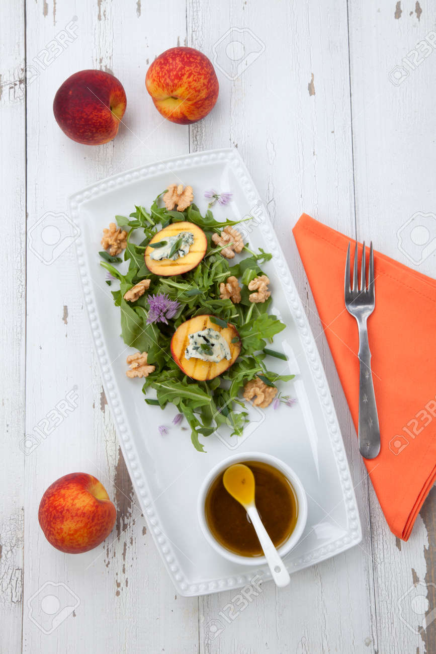 Closeup of blue cheese and peach salad with walnut and arugula. Freash peaches. - 165024010