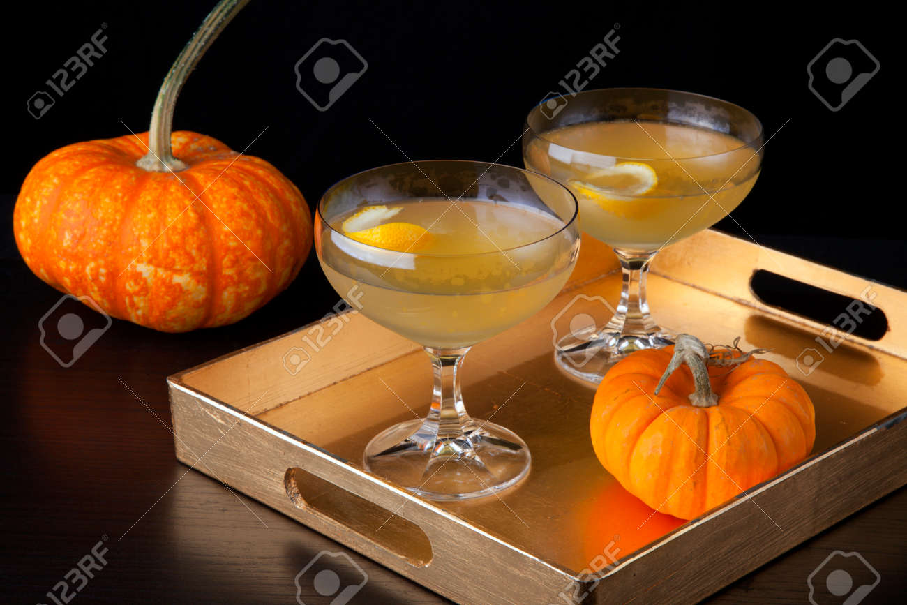 Closeup of Champagne Cocktail on a tray with mini pumpkins. Fall Drinks series. - 171621584