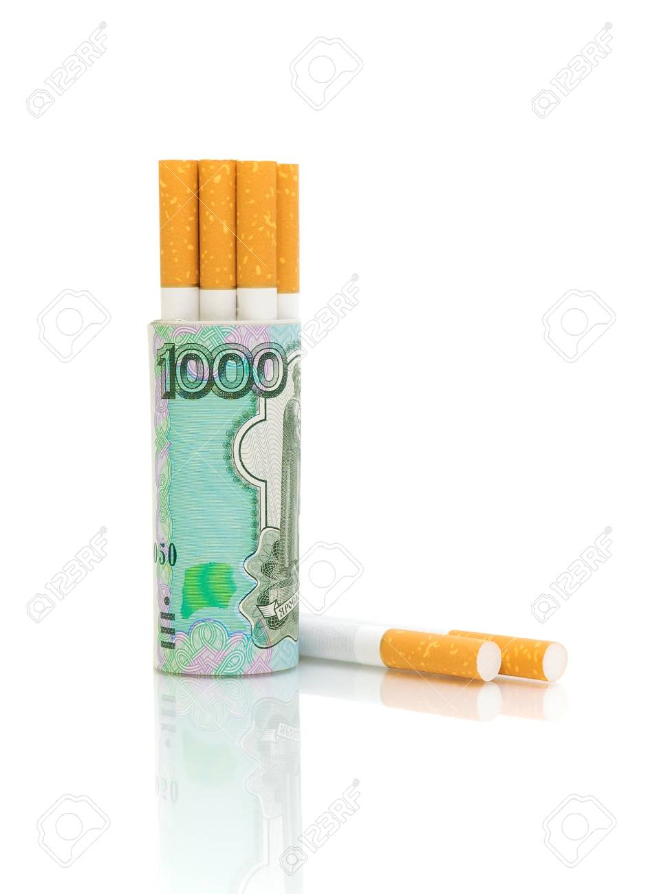 Cigarettes and banknotes on a white background. The concept - expensive habits. Stock Photo - 13746877
