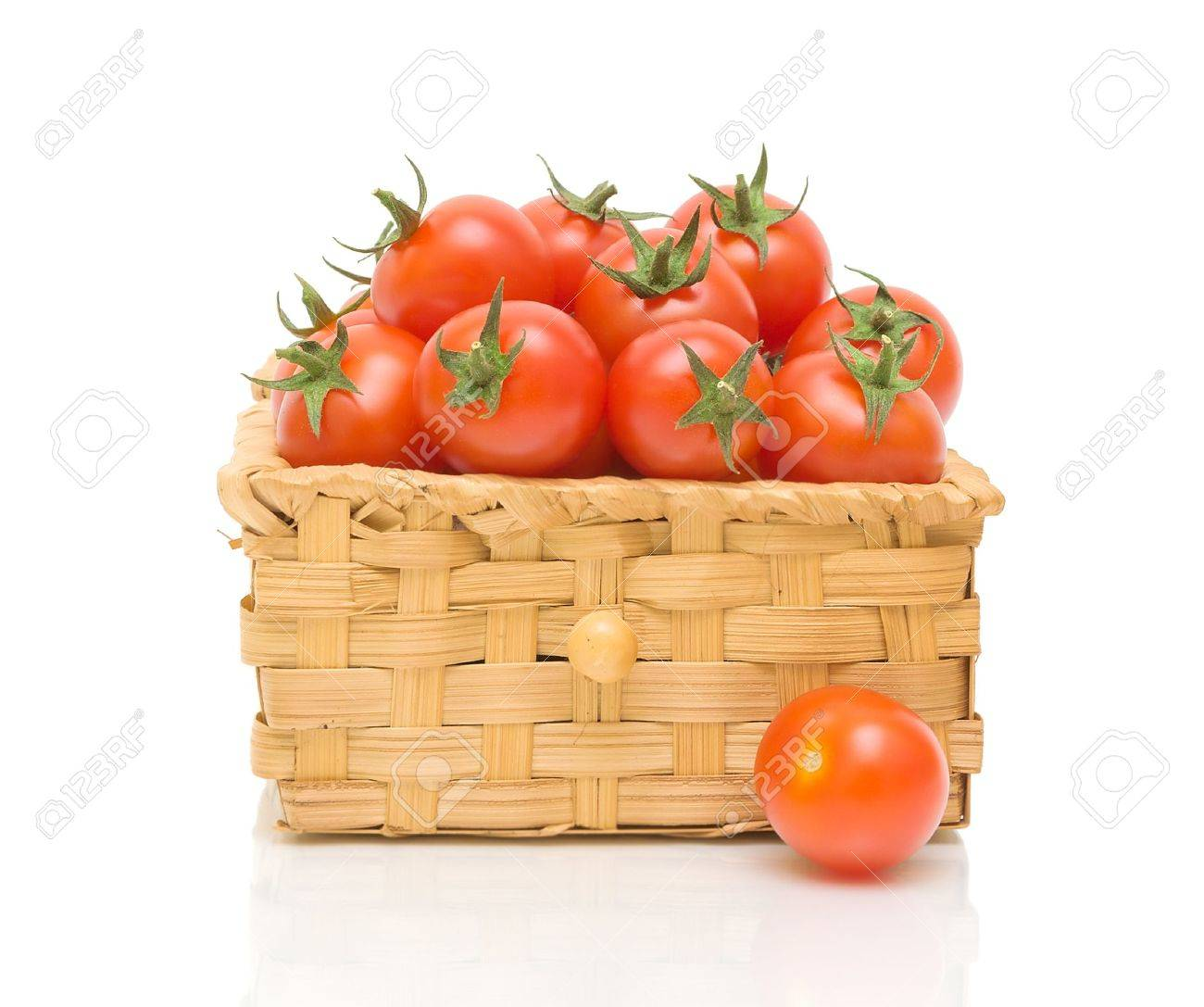 ripe tomatoes in a wicker basket isolated on white close-up of the reflection Stock Photo - 13845121