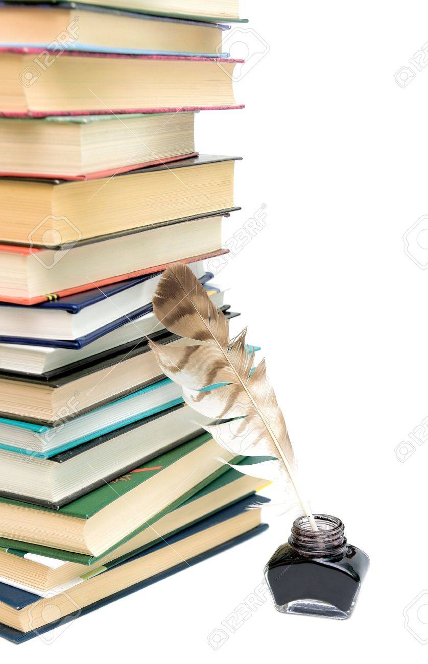 school supplies. quill in the inkwell and a large stack of different books on a white background close-up. Stock Photo - 18732412