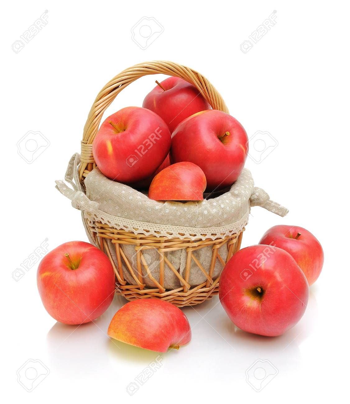 red apples in a wicker basket on a white background. vertical photo. Stock Photo - 18786433