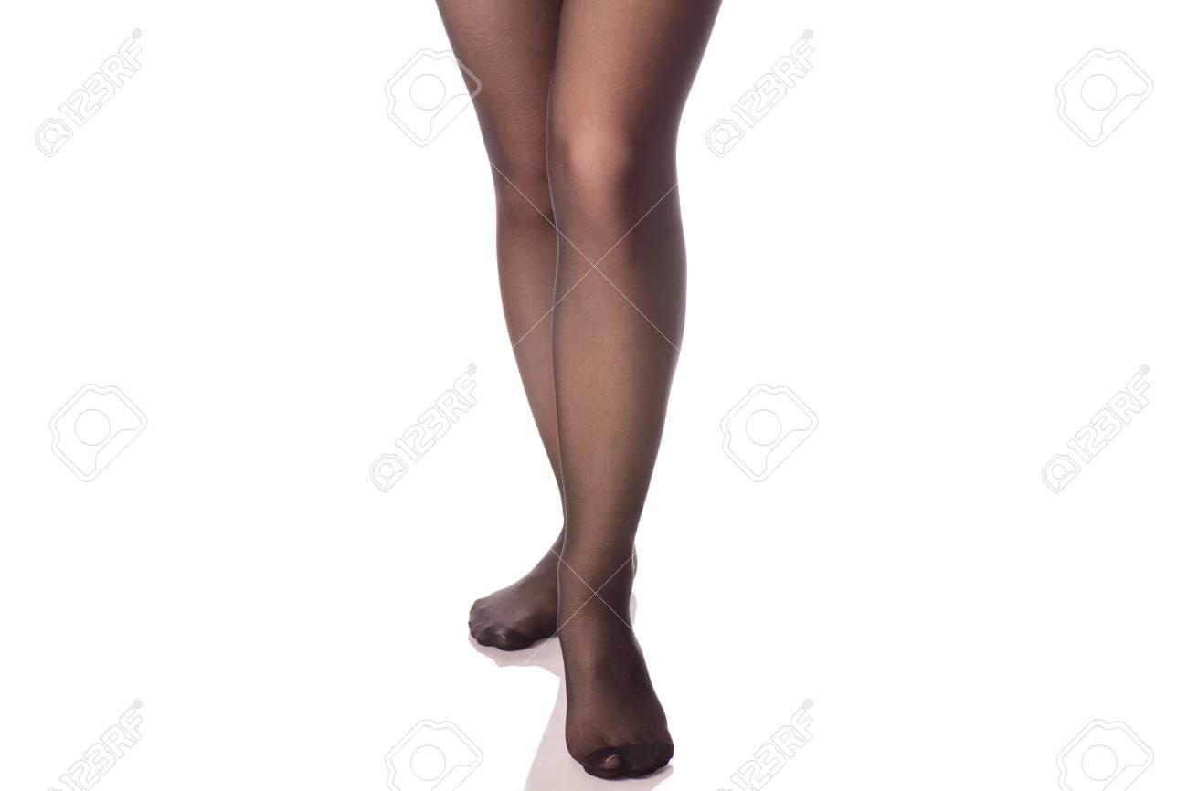 5fcdda21b52 Female legs black stockings tights on white background isolation Stock  Photo - 90539513
