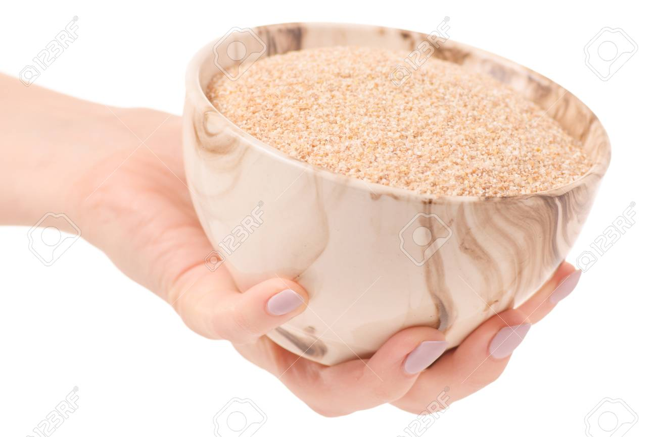 91908262-wheat-porridge-millet-hand-on-w