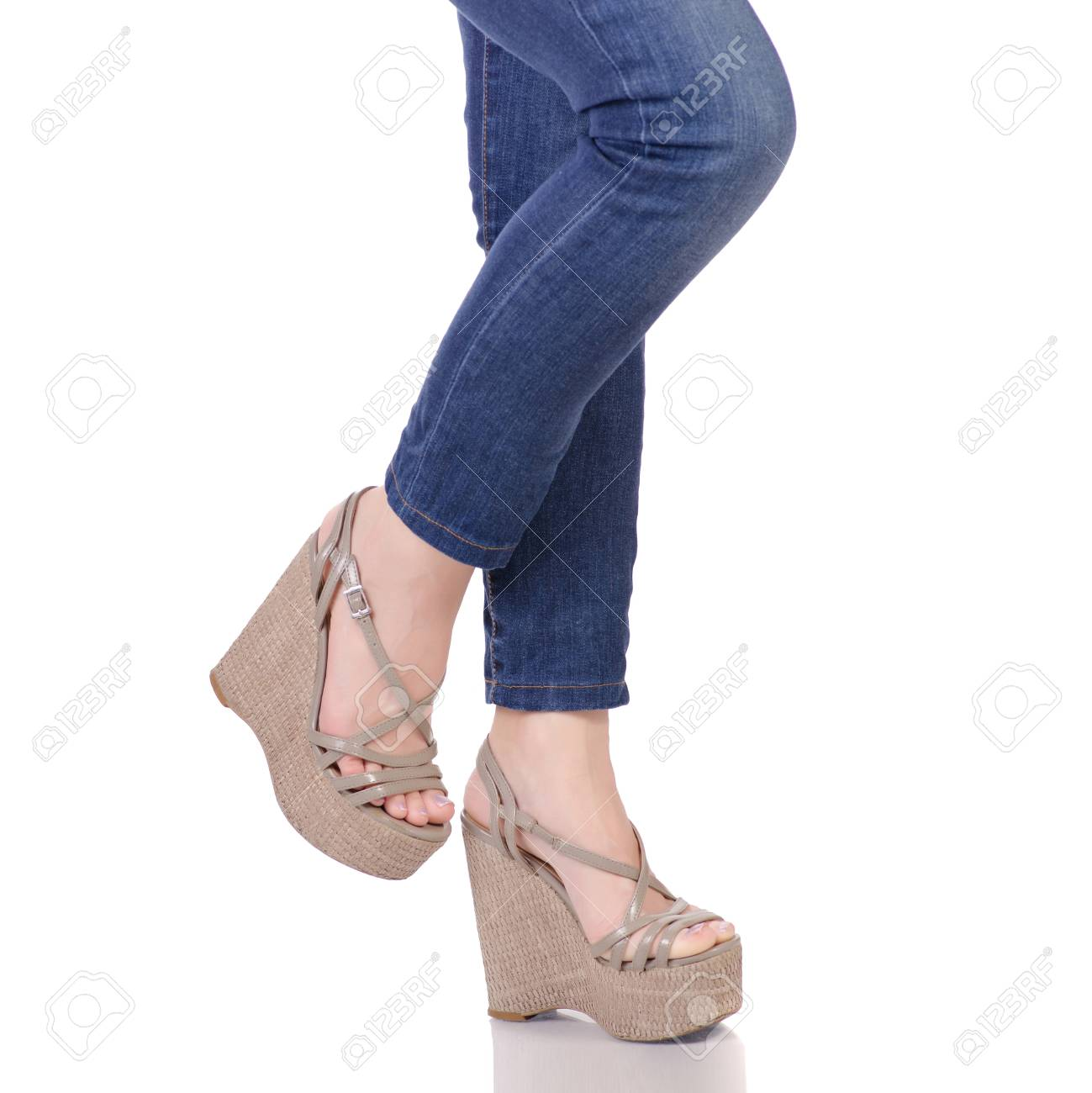 fcb18ff2be89 Female legs in jeans and gray sandals on a wedge buy shop fashion beauty on  a