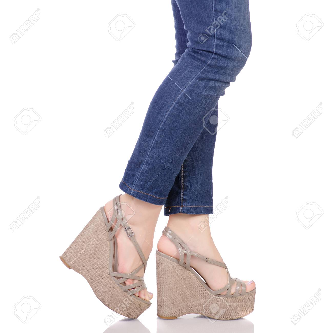 ee781c257 ... white background isolation. Female legs in jeans and gray sandals on a  wedge buy shop fashion beauty on a