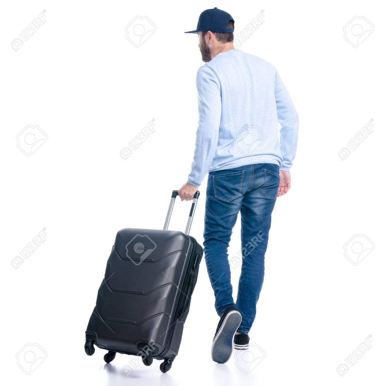 Man in jeans with travel suitcase goes walking - 144518390