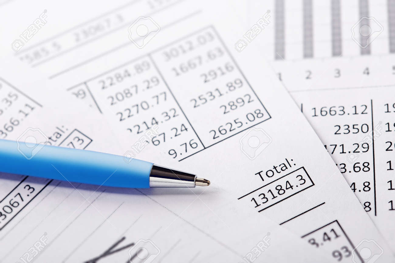 Accounting document with pen and checking financial chart. Concept of banking, financial report and financial audit. - 152661360