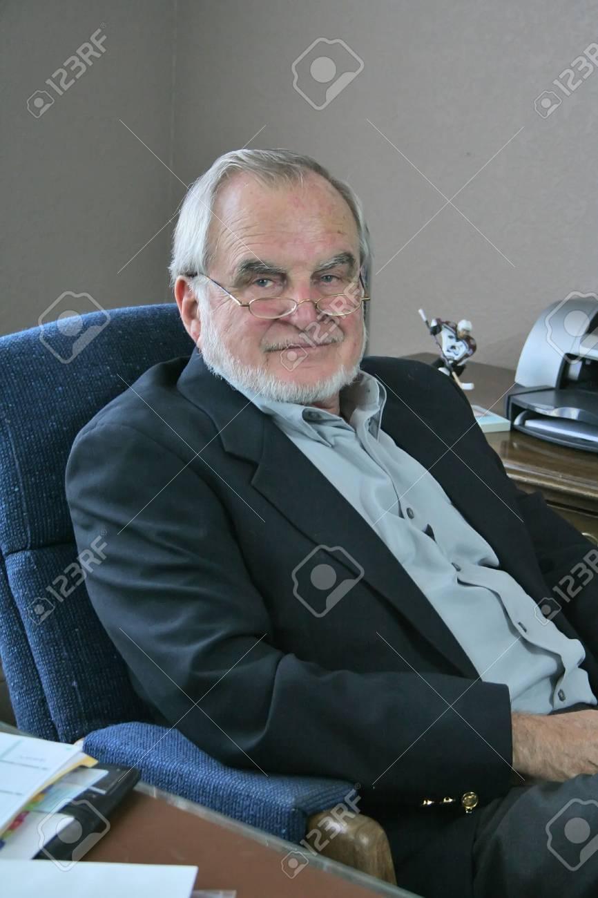 Mature business man sitting at desk Stock Photo - 2464262