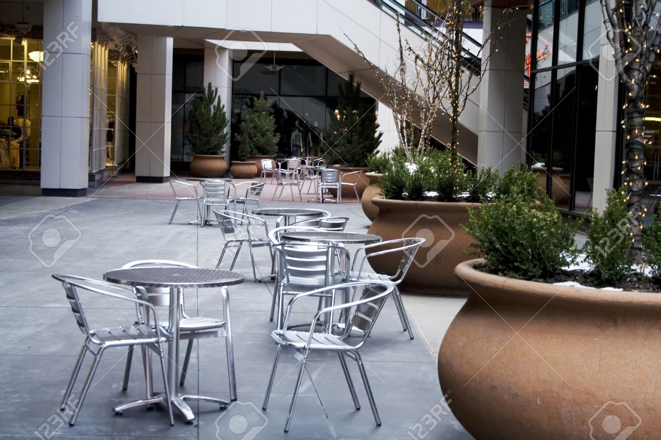 Modern cafe chairs and tables - An Outdoor Cafe With Tables And Chairs And Lights Stock Photo 3351576