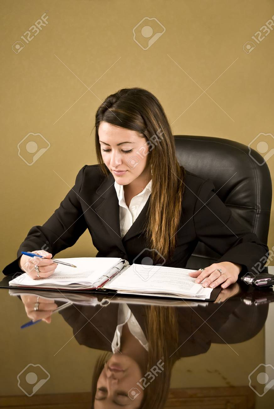 A young business woman working at her desk Stock Photo - 4088473